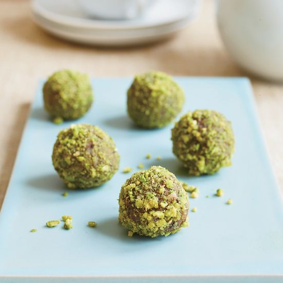 """Elizabeth Falkner loves eating these energy-boosting, cardamom-spiced date bites made with almonds, walnuts and pistachios. """"Eat two of these as a sna..."""