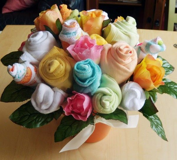 baby bouquet! What you'll need: 5 pack of onesies, 5 pack of washcloths, 3 pack of baby socks, 3 pack of newborn hats, Terra cotta pot, Small block of oasis, Thin gauge floral wire, Thick gauge floral wire, Floral tape, Wire snips, Silk flowers