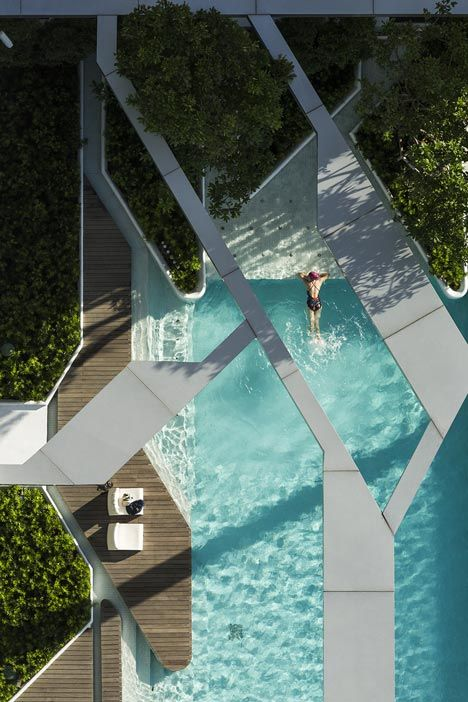 The Pool at Pyne by T.R.O.P. Residents look down at the pool, so the architects added a geometric concrete superstructure to give swimmers a three dimensionality.