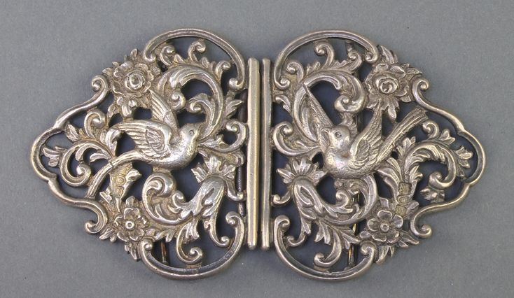 Lot 503, A Victorian cast and pierced silver buckle in the form of doves amongst flowers, London 1897, 94 grams, est £60-90