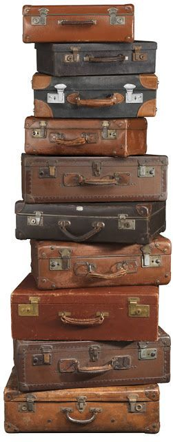 vintage suitcases stacked high