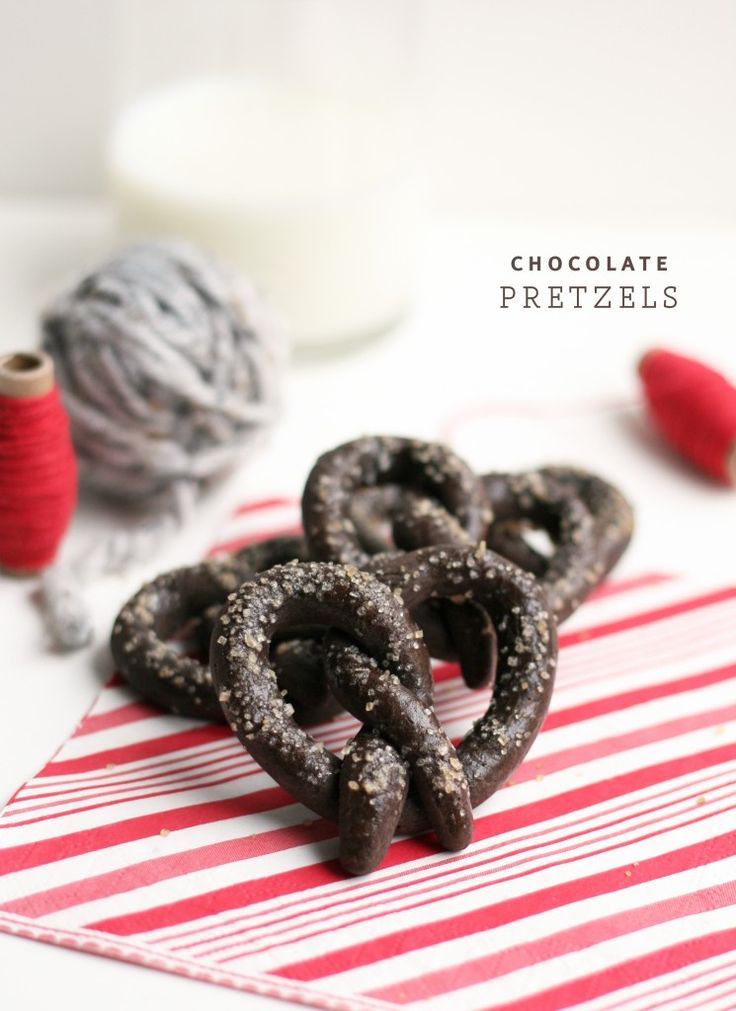 Chocolate Pretzels -1/4 c. unsweetened Dutch-process cocoa powder 1 tsp. good-quality instant espresso powder 3 tbsp. boiling water 1/2 c. (1 stick) unsalted butter, softened 1/3 c. granulated sugar 1 tsp. pure vanilla extract 1/2 tsp. coarse salt 1 large egg 2 c. all-purpose unbleached flour 1 large egg yolk Sanding sugar, for sprinkling