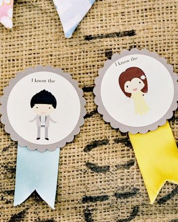 """Zoe's sister Michelle made """"I know the bride"""" and """"I know the groom"""" badges using John's illustrations. Guests pinned them on before the ceremony."""