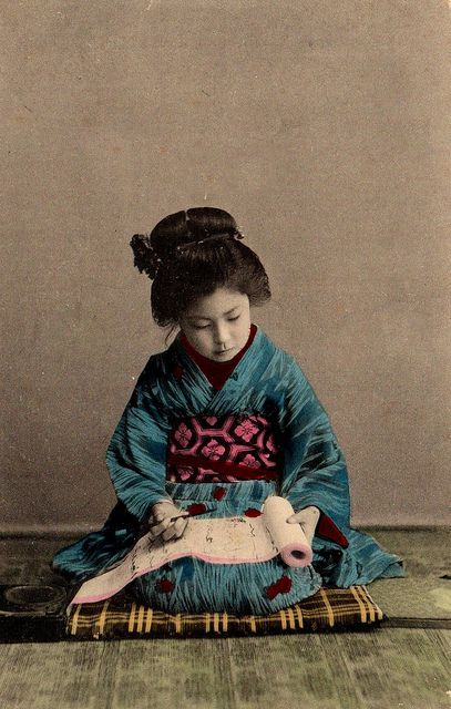 Maiko Child on Flicker Photo-stream: Precious Young Maiko Girl practises her calligraphy.