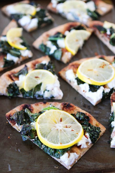 Meyer Lemon, Kale, and Goat Cheese Flatbread Recipe on twopeasandtheirpod.com Love this easy and healthy flatbread recipe! Perfect for lunch, dinner, or as an appetizer for parties!