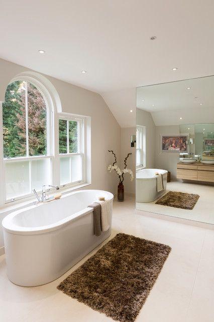 window cling film Bathroom Transitional with arch window brown bath