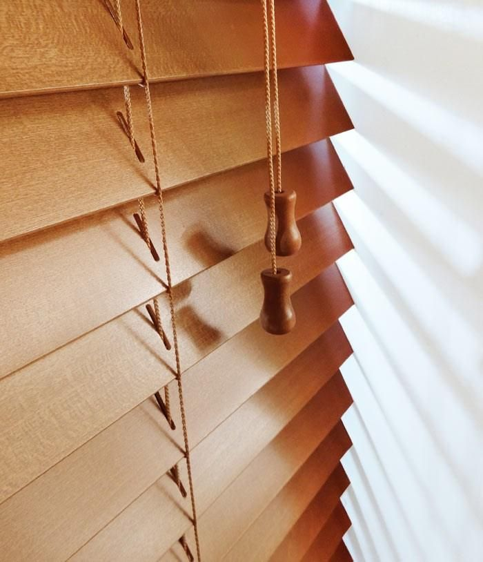 a window with a 50 mm Bronzed Oak Express Dlelivery Wooden Venetian Blind with mactching Ladder Cords