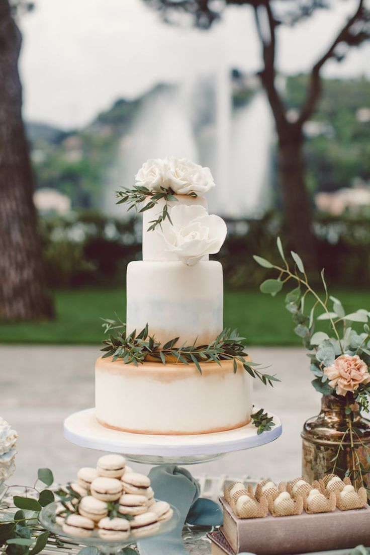 Dessert Table Cream Gold Blue Wedding Cake Large Handmade Roses Green Leaves Sweet Treats Flowers Greenery Water Fountain Trees Breathtaking Lake Como Wedding Ideas http://lillyred.it/