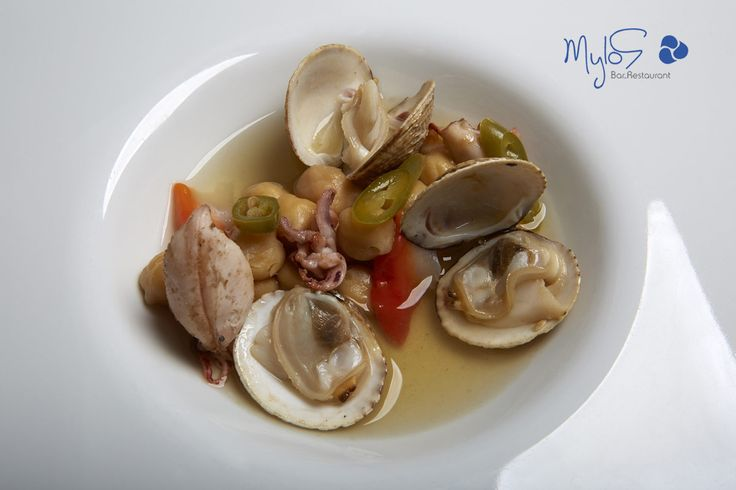 Chickpeas with seafood – The ultimate combination for your taste buds! more at mylossantorini.com