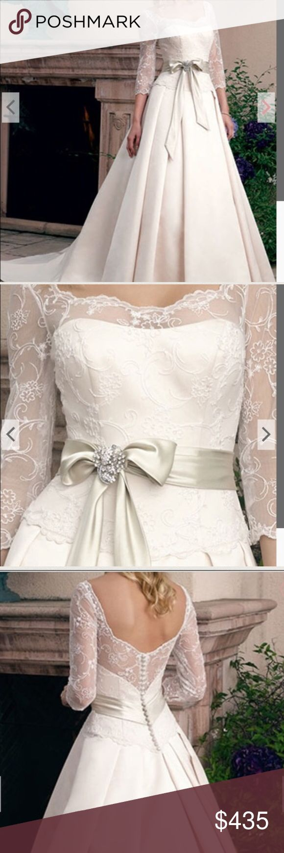 """Like new Casablanca bridal wedding ball gown dress Like new Casablanca Bridal 1800 wedding gown in ivory & champagne! Retail $1399. Purchased August 2016, worn indoors in September & dry cleaned. Street size 10, never altered, bustle sewn in. Brooch in stock photo NOT included. Beaded lace, sweetheart bodice, 3/4 length sleeves. Box pleats in skirt, chapel train,  satin tie and bow at waist. Measurements: shoulders 16"""" bust 37"""" waist 31"""" length down front is 63"""" from top of shoulder to…"""