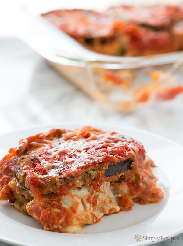 A classic Italian baked eggplant Parmesan casserole with breaded eggplant slices layered with Mozzarella, Parmesan, basil, and tomato sauce.