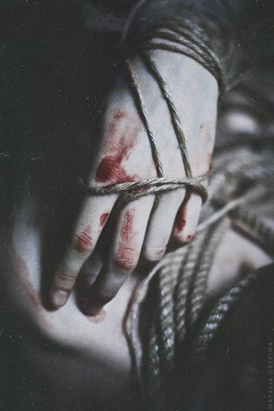 "(Open rp...  be rescuer) I manged to get the ropes that bound my wrists over my hands, but they still squeezed at my fingers. They were throbing and blood had started to run down my hands seeping into the ropes. I heard a door open and I was momentarily blind as the unnaturally bright light hit my face.   I let out a stangled and hoarse sob as the figure grabbed my hands and retied the ropes tighter. A low, male laugh echoed through the room. ""Just wait."""