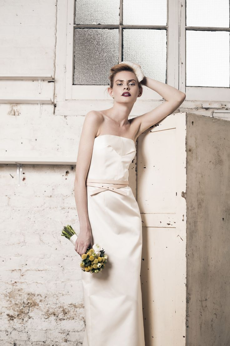 Modern wedding dress for the contemporary bride. Taylor dress, Rosamund train - Muscat Bridal. Strapless silk duchess dress, with pencil skirt, back slit and boned bodice. Tulle train.