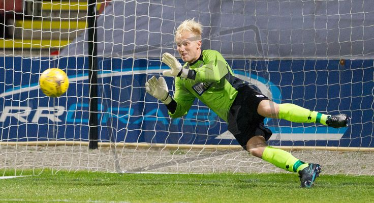 Queen's Park's keeper Marc Waters saves a penalty during the IRN-BRU Cup game between Partick Thistle Colts and Queen's Park