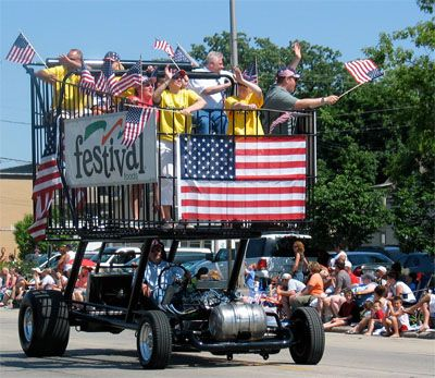 """Here's how they do Flag Day in Appleton, Wisconsin: A crowd of 60,000 people filled the city of Appleton, Wisconsin on June 10, 2007, to celebrate the city's sesquicentennial and the annual Flag Day Parade. This """"float"""" from Festival Foods sports a shopping cart powered by a spit-and-polish chrome plated engine and a beer keg to hold the gas."""