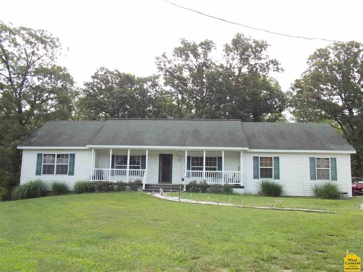 Beautiful Ranch style manufactured home on 2 ac. 3 BD, 2BA lots of custom features, including custom cabinets, arched doorways, laminate flooring and large baths and walk-in closets. Home sets on 10 lots, almost 2 acres. Covered front and back porch. All new lateral lines to septic. Large Detached 2 car garage w/ RV hookup w/ holding tank for Rv. New underground storm shelter installed in Warsaw MO