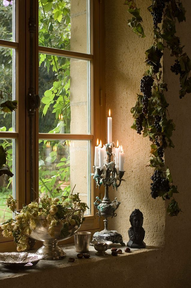 The Moulin Bregeon is in the Loire Valley countryside . Along with the antique fairs and it's endless supply of beautiful objects, the abundant nature which surround the Moulin is a constant source of inspiration. Enjoy the ghostly reflection of the candles in the window!