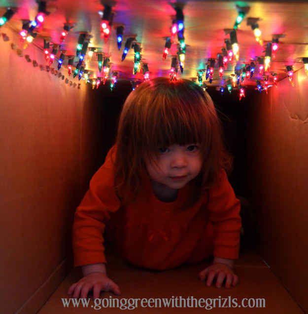 Use a cardboard box to DIY a light tunnel.