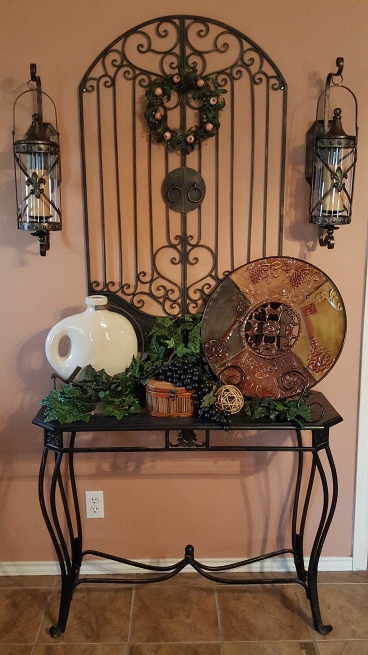 My entry decor. The sconces and large decorative plate was purchase from Walmart. com and the garden gate from Hobby Lobby. I love Mediterranean decor.