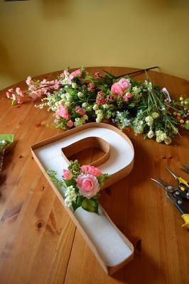 This could be so beautiful for a wedding. styrofoam letter with flowers