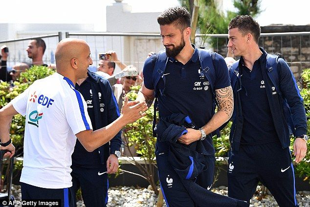 Arsenal stars Olivier Giroud (centre) and Laurent Koscielny (right) arrive in Biarritz to meet up with France