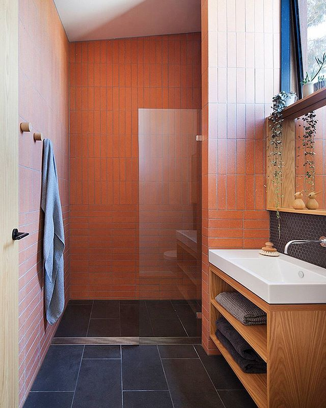 WEBSTA @ lunchboxarchitect - How great does this terracotta tiled bathroom look? We love the natural earthy hues and hardwearing quality of terracotta. This beautiful bathroom was designed by @antmartarch for the Carlton Cloister and photographed by @shannonmcgrath7