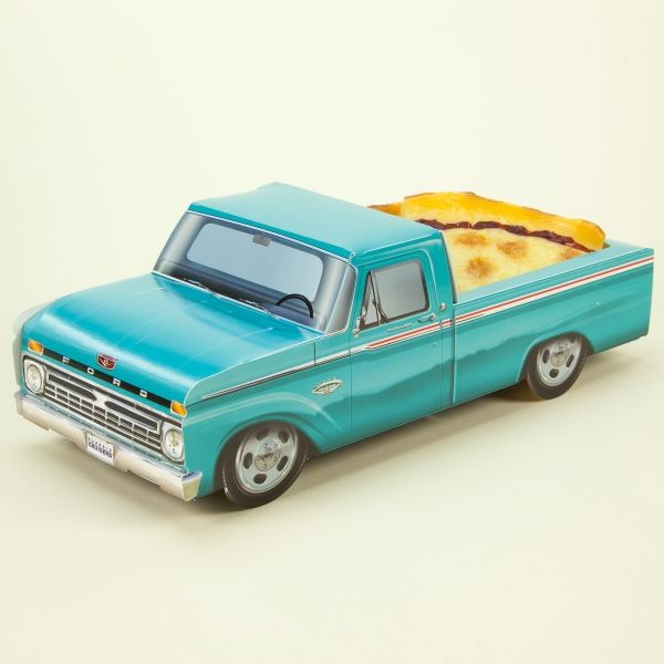 Made of thick paperboard, this Classic Cruisers car carton is the perfect centerpiece for a 1960s theme party. This paper replica of a vintage teal Ford pickup truck folds together and can be used as a candy goodie basket or retro table decoration. Great for kids birthdays, reunions and anniversary parties. Available plastic inserts turn it into the coolest food tray around. Affordable and fun. Officially licensed. Measures 11
