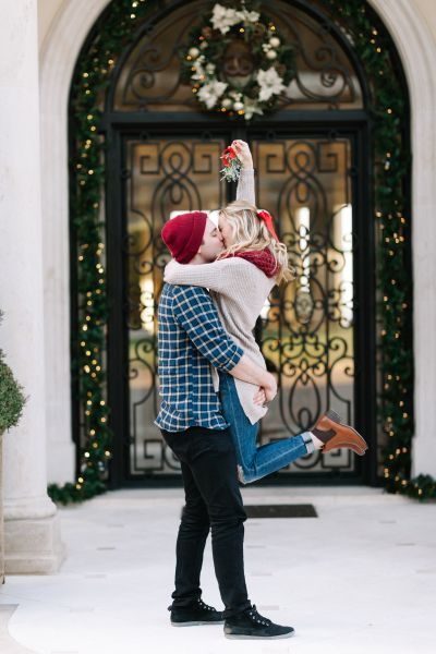 Engagement announcement under the mistletoe: http://www.stylemepretty.com/2016/09/24/engagement-announcements-you-havent-seen-a-million-times-on-facebook/