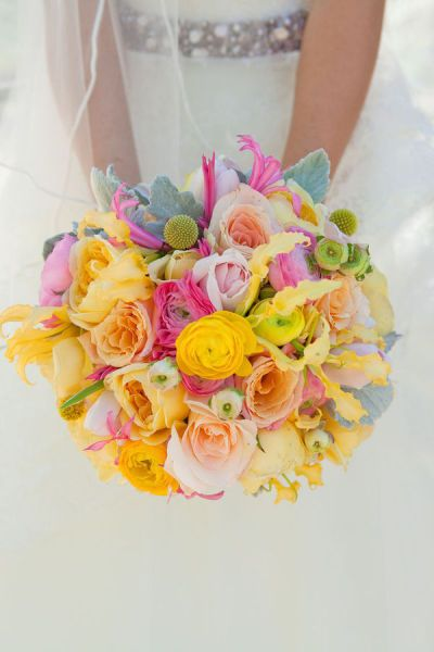 Pretty yellow, pink, and peach bridal bouquet.