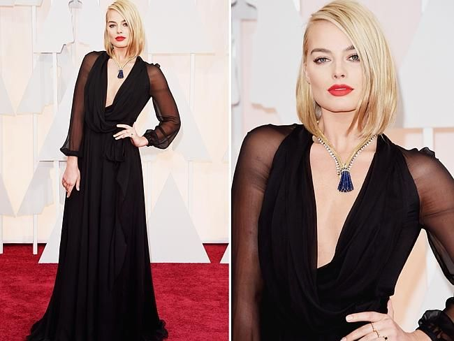 Margot Robbie in YSL at the Oscars 2015 red carpet. The former Neighbours star also accessorised her look with a Van Cleef & Arpels necklace.