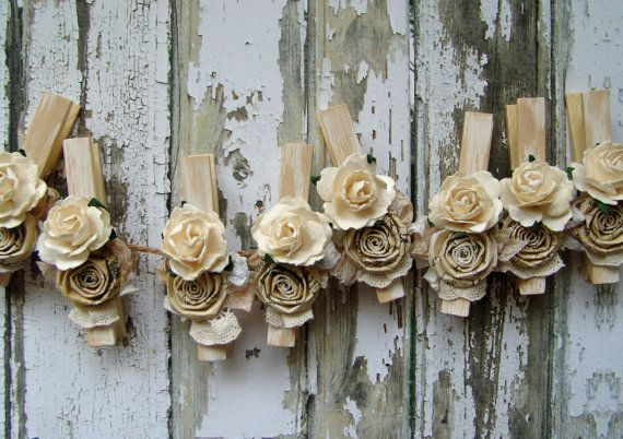 Shabby Chic Ivory decorated clothes pins Set of 8 clothing pegs with handmade paper flowers cottage chic cream. $17.95, via Etsy.
