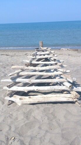 Strange construction with white woods brought by the sea in the Principina beach,Grosseto, Tuscany