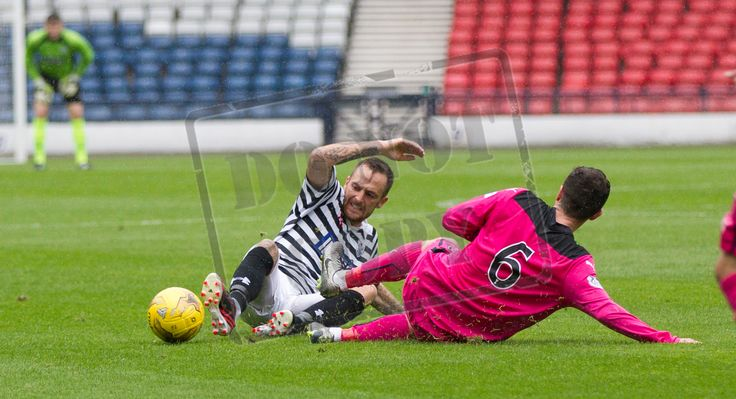 Queen's Park's Darren Miller tackled during the Ladbrokes League One game between Queen's Park and Airdrieonians.