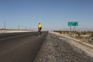 Riding a long-tail bicycle with an attached armature arm to hold chalk, Joseph DeLappe cycles through the hot southern Nevada desert outlini...