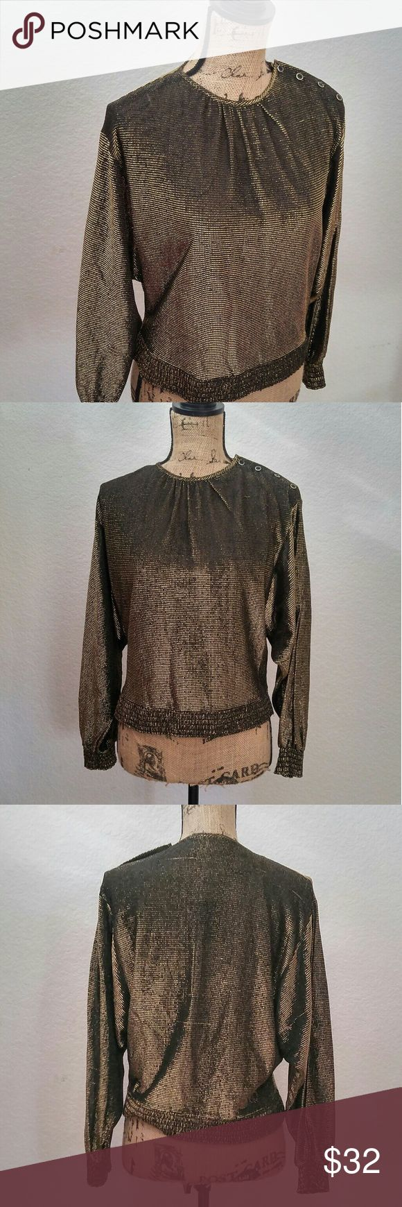 """70's Black & Gold Shimmer Batwing Shirt In the sun this blouse is the epitomy of 70's rock glam! The glitter & gold & and the semi sheer bag wing sleeves make this shirt absolutely stunning. Like all vintage it's one of a kind, so if you love it make it yours before someone else does. If this was my size there is no way I'd be selling it!  Shoulder to shoulder 18"""" Bust/ Underarm to Underarm 20"""" Waist 17""""-19"""" Length 20"""". Choose a free pair of Leg Luxury tights with any purchase of $45 or…"""