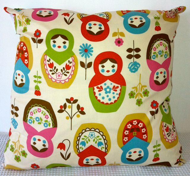 Kokka colorful babushka motif on cream background cushion cover, slip cover, throw pillow, decorative cushion, accent pillow. $29.95, via Etsy.