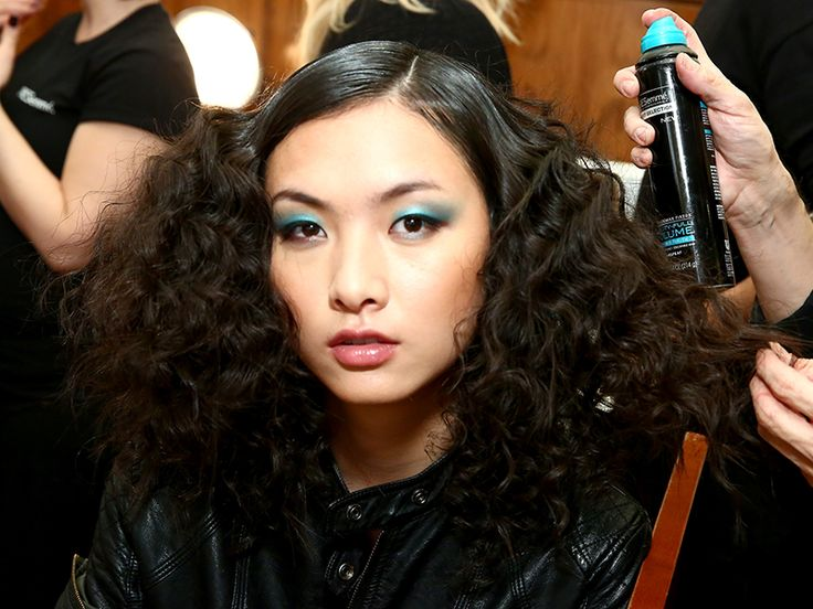 Electric blue eyeshadow and big curls make for an ultra '70s beauty look