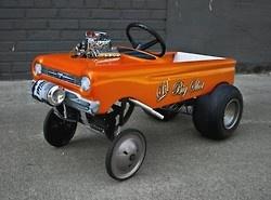 Pedal car gasser.      Luv it ...............D