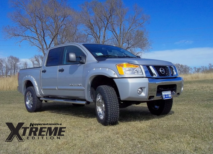 "2012 Nissan Titan Kupper Automotive Xtreme Package:   3"" Lift Kit  20"" Rims with Nitro Terra Grappler A/T  Step Tubes  Painted Bushwacker Wheel Flares"