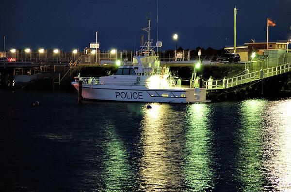 http://fineartamerica.com/featured/police-boat-cheryl-hall.html