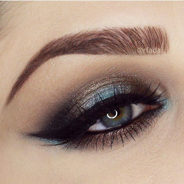 #tbt @anastasiabeverlyhills shadows TRUFFLE GLITTER (brassy gold shade) all over the lid. Darkened the inner and outer corner with NOIR (black matte). The pop of color in the middle and accent corners is created using ICE BLUE waterproof creme color, set with AQUA shadow. And lastly, I blended the crease with a medium brown shade called FAWN. I lined my entire eye with @sigmabeauty Black Gel Eyeliner WICKED I'm wearing @hudabeauty @shophudabeauty in SASHA.