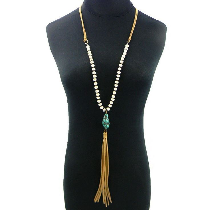 Suede leather fringe necklace with pearl beads and a single turquoise stone drop. Available in Tan or Brown.