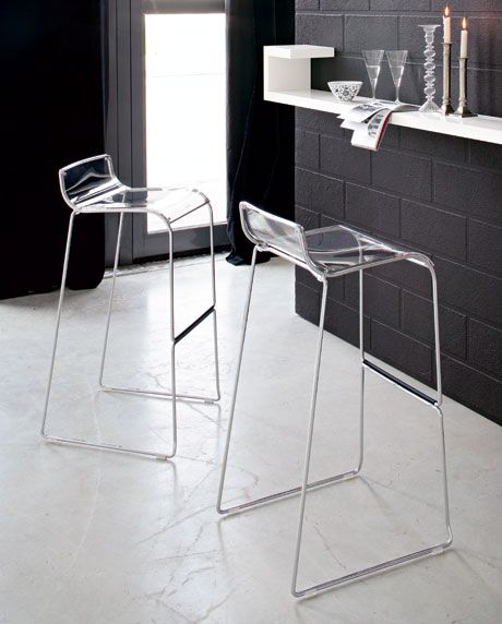 The Calligaris Irony Polycarbonate Bar Stool or Counter Stool really has nothing to do with Irony. Suitable for use at breakfast bars or high café tables.  Irony has a polycarbonate seat that curves up at the back and down at the front; available in a range of different colours. It features a slender yet sturdy metal sled base with plastic-covered footrest.