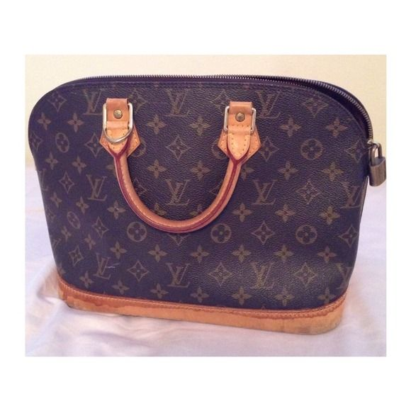 Louis Vuitton Alma bag 100% authentic!!! Pre-owned but still has a lot of life left to it. There are some water damages on the bottom. Pls take a look at the very last picture for some of the flaws. No trades, I will not respond to those who asks to trade. Louis Vuitton Bags