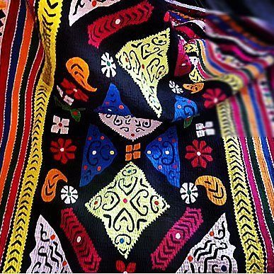 The Godhdi (quilts) made by Muttvas.  The Mutvas from the Banni region of Kutch are among the most prolific when it comes to styles of embroidery.  They had migrated from Sindh many centuries ago most likely in search of fodder for their cattle.  Some of the most beautiful crafts of the Mutvas get created around wedding. From around when a girl is 8 to 9 years old, till the age of 21 or 22, she embroiders 7 kanjeris ( blouses), 21 Godhdis ( quilts) and 2 covers for Thakiyas.  The groom in…