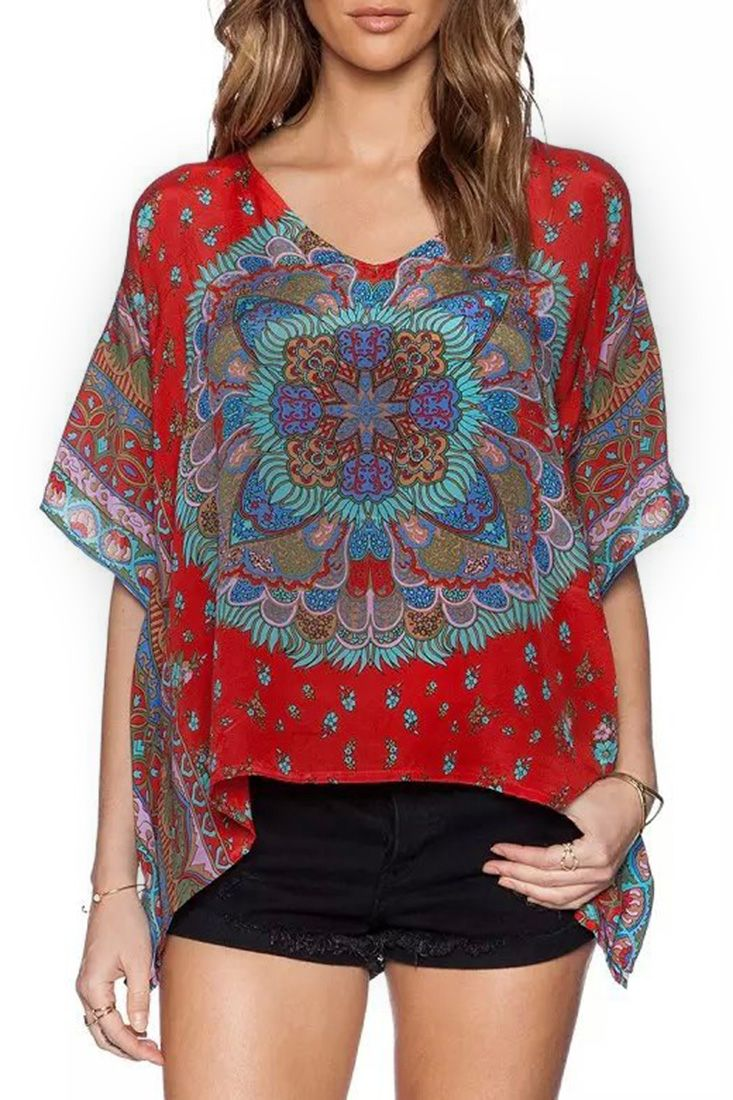 The blouse featuring vintage pattern. V neck. Short sleeves.