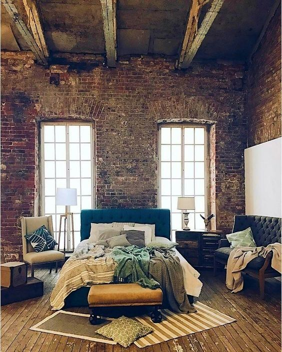 We love this room's rustic qualities. From exposed brick walls to aged wood flooring, this bedroom's character is what we aspire to create.