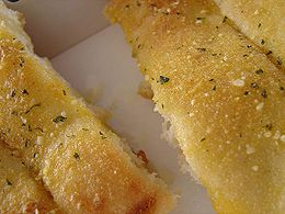 Domino's Breadsticks- You can create delicious cheesy breadsticks by adding your favorite shredded cheese on top of the dough before placing it in the oven. Visit CopyCat Recipe Guide for the recipe. http://www.copycatrecipeguide.com/How_to_Make_Domino%27s_Breadsticks