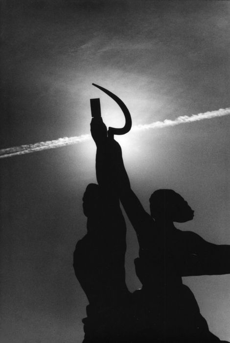 Photo by Sergey Borisov. Sunset. 1985.  Mukhina sculpture Worker and Collective Farm. 2003.