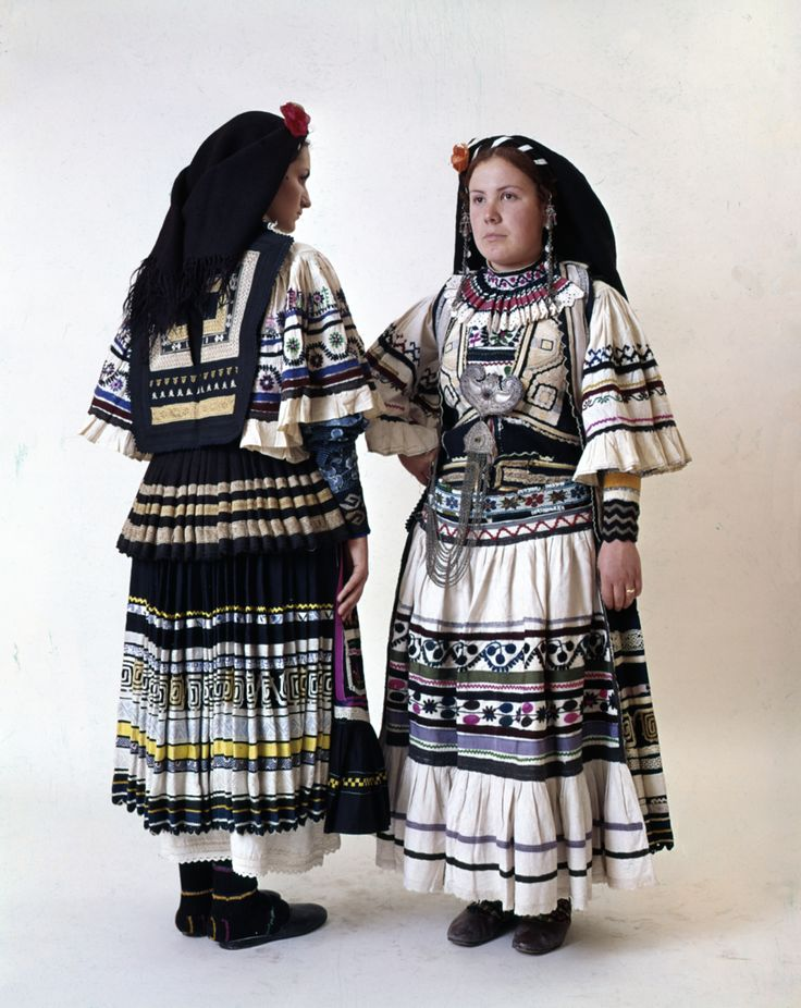 "Two women's Sarakatsans nomad costumes, the variation know as ""Serviana"". It is characteristic of the Sarakatsans who were confined to Serbian territory during the persecution of 1906-1924. They were allowed to return after World War II."
